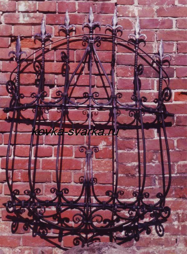 Фото кованой оконной решетки