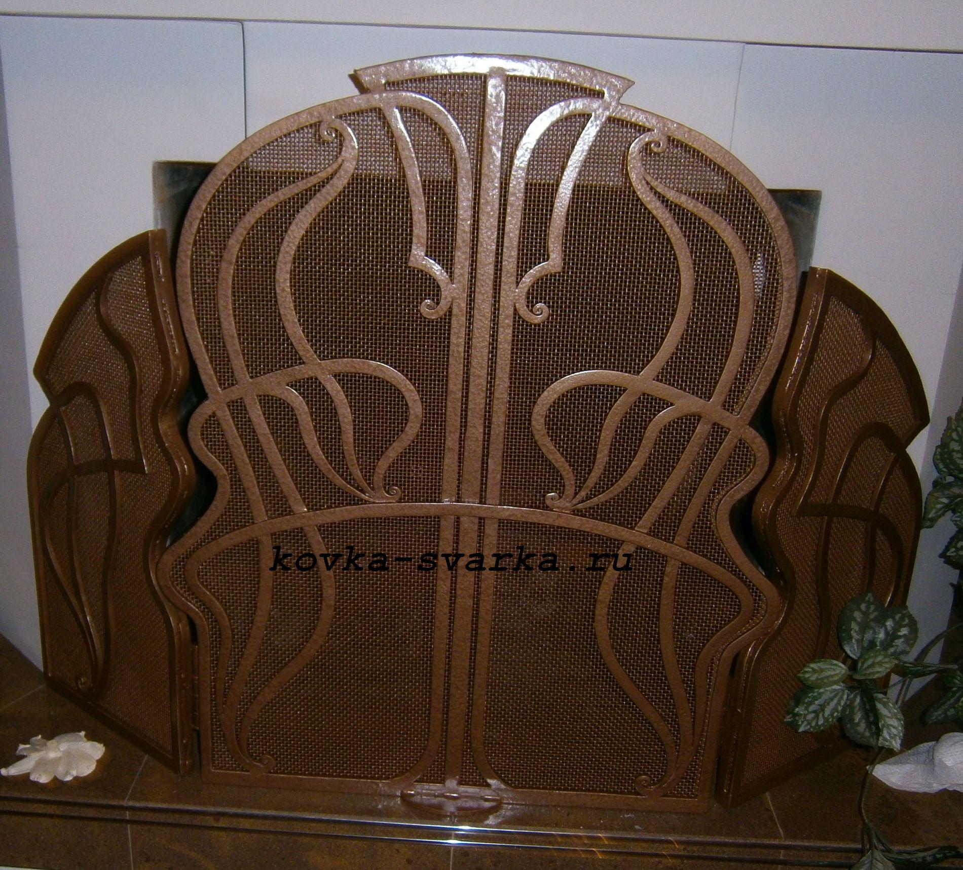 Фото кованой решетки для камина